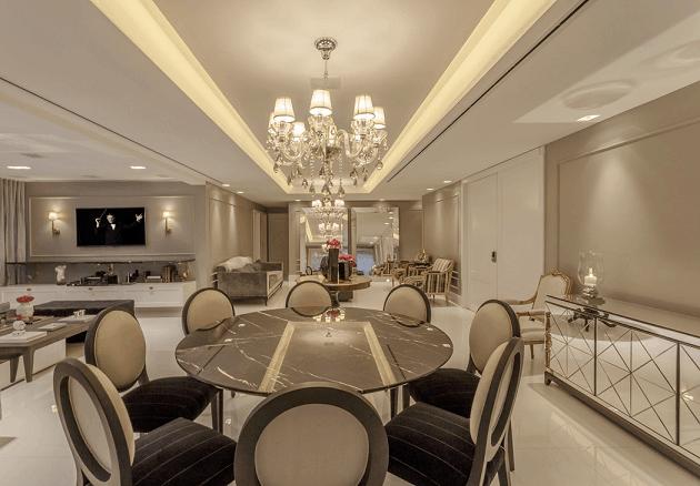 sala de jantar com mesa redonda classica e elegante