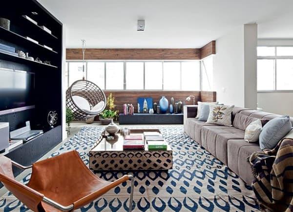 Sala moderna com tapete geometrico azul