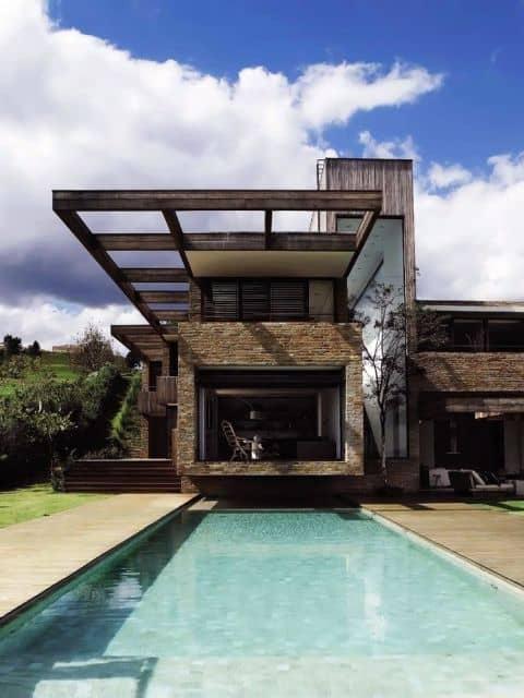 01 fachada de casa moderna com pedra rustica