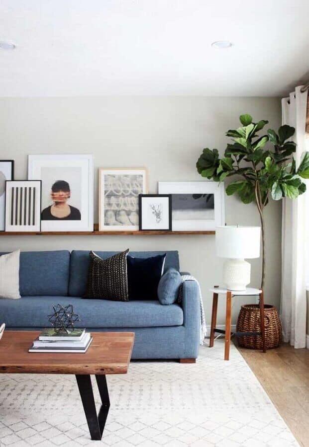 sala elegante e moderna com sofa azul