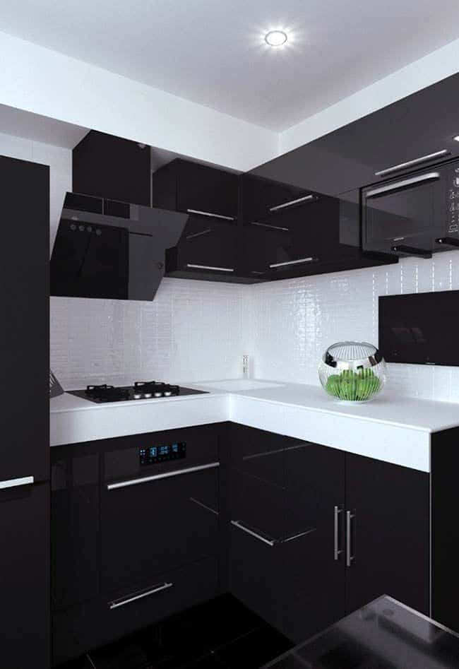 cozinha com piso preto e moveis preto e branco