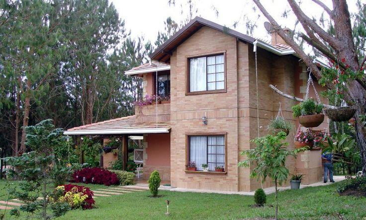 07 casa de dois andares com tijolo aparente