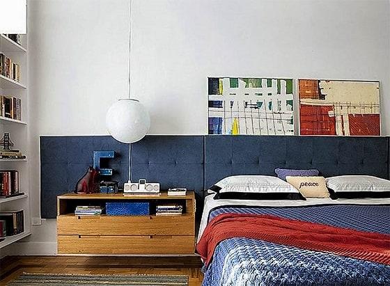 quarto com cabeceira azul marinho
