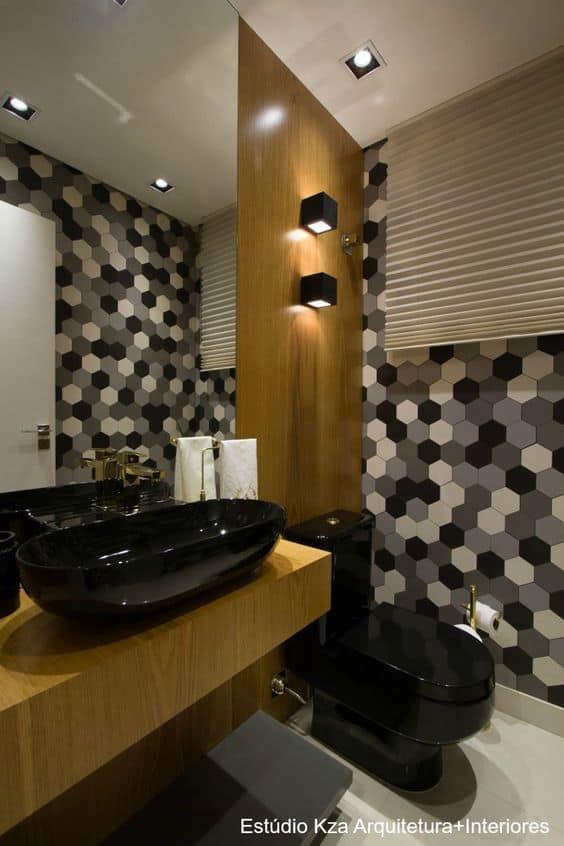 lavabo decorado com preto e branco e cuba e vaso preto