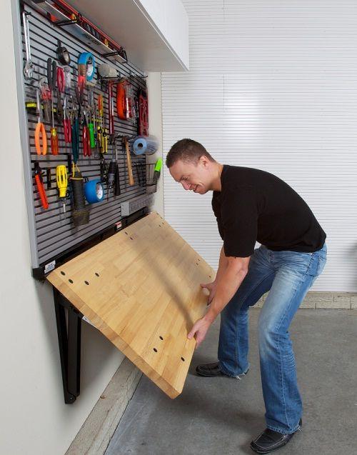 painel para ferramentas e mesa retratil na garagem
