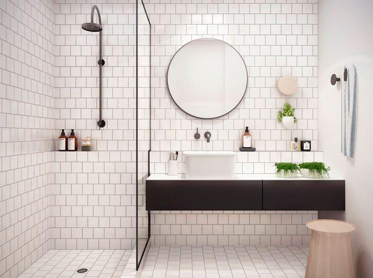 banheiro com azulejos brancos e rejunte preto