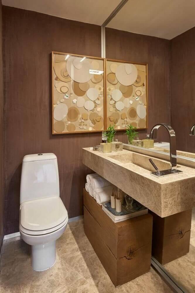 Lavabo com painel de madeira e tampo com cuba esculpida em mármore