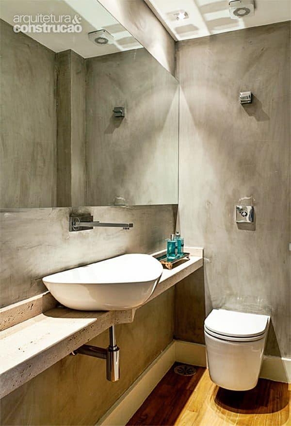 Cimento queimado nas paredes do lavabo moderno