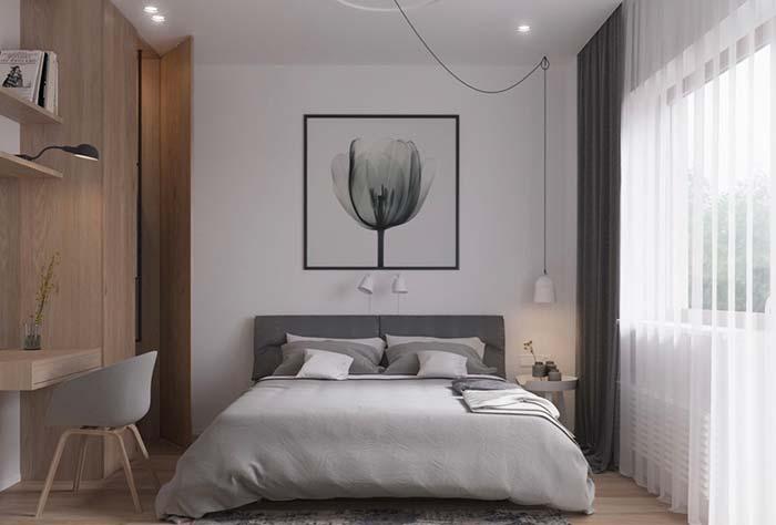 Quarto moderno com pendente do lado da cama e home office