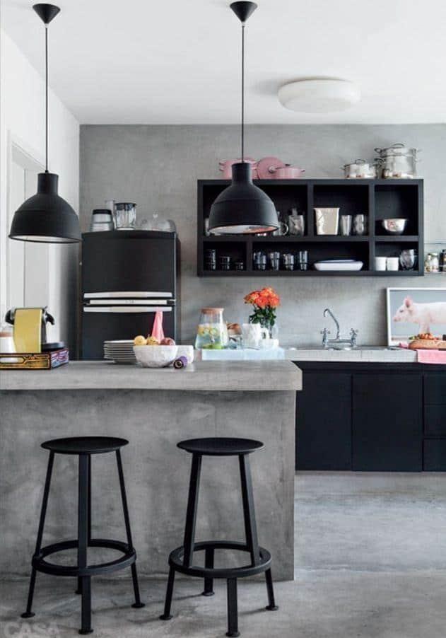 Cozinha integrada com bancada de cimento queimado