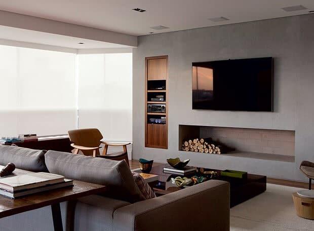 sala moderna com lareira de cimento queimado embaixo da tv